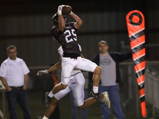 Chiles' Bryant McKnight intercepts a ball against Leon
