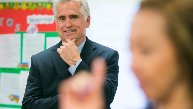 State Superintendent of Public Instruction John Huppenthal visits a Spanish-immersion class at Scottsdale's Pueblo Elementary in 2013.