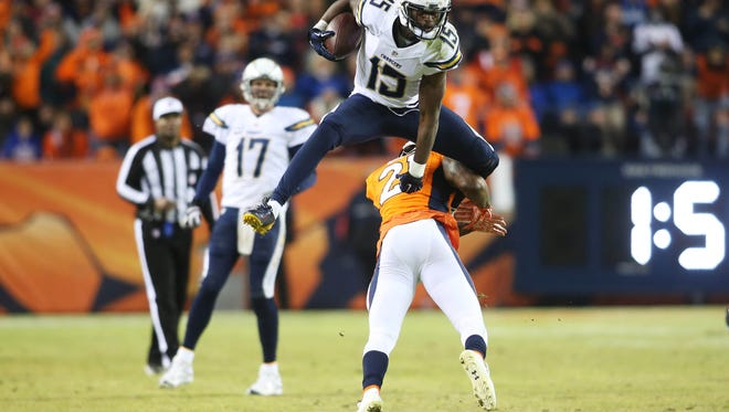 San Diego Chargers wide receiver Dontrelle Inman (15) leaps over Denver Broncos cornerback Aqib Talib (21) on Jan. 3 after making a catch during the second half at Sports Authority Field at Mile High. The Broncos won 27-20.