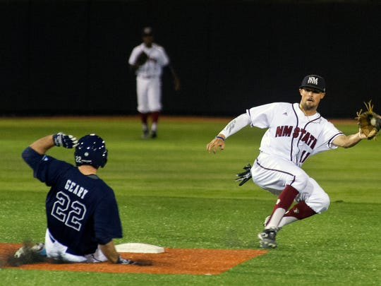 New Mexico State shortstop L.J. Hatch has to come off the bag at second to field a throw from catcher Mason Fishback as Maine's Brenden Geary picks up the stolen base Friday night at Presley Askew Field.