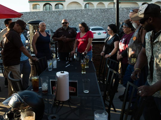 Robert Chavira, center, and his girlfriend Gladys Padilla spoke at a gathering of six  motorcycle clubs who together to raise money for Cecilia Mata who is fighting breast cancer and currently looking for a new place to live, Friday, March 10, 2017 at Wing Daddy's.