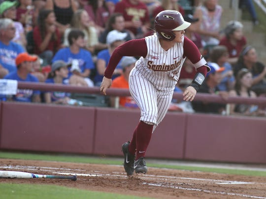 FSU's Jessica Warren watches her solo home run go over the ffence in their 3-1 win against Florida in front of a record crowd at JoAnne Graf Field on Wednesday.