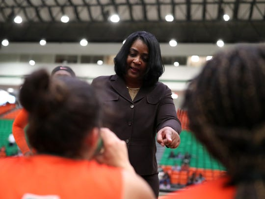 FAMU Head Coach LeDawn Gibson talks to her team during a timeout in their game against  Delaware State at the Al Lawson Center on Monday, Jan. 15, 2018.