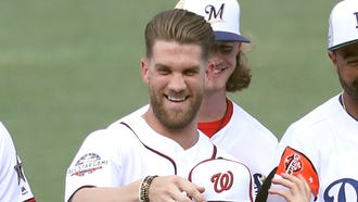 Bryce Harper jokes with teammates during the team photo shoot.