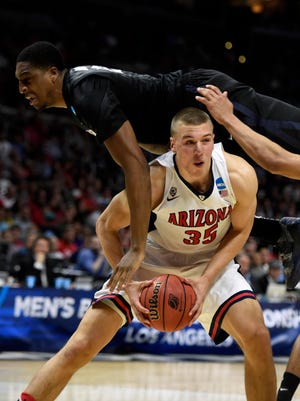 March 26, 2015; Los Angeles; Xavier Musketeers forward James Farr (2) falls on top Arizona Wildcats center Kaleb Tarczewski (35) during the second half in the semifinals of the West Regional of the 2015 NCAA Tournament at Staples Center.