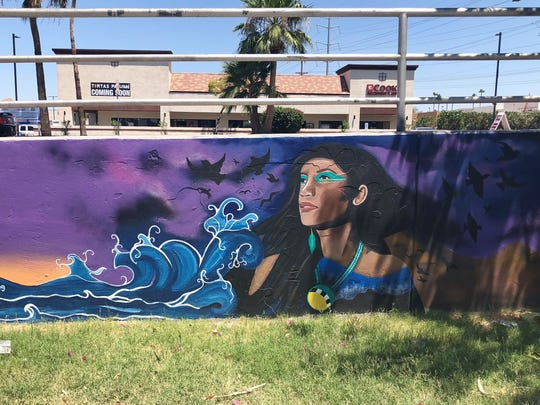 Lucinda Yrene painted this portion of the wall outside Azukar Coffee on Central Avenue and Baseline Road.