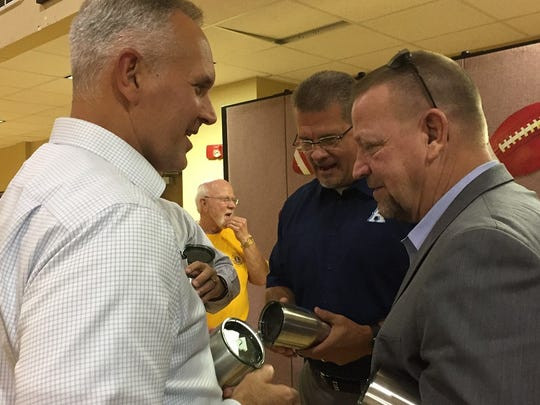 Bossier Parish Schools athletic director Mitch Downey (right), Airline principal Jason Rowland (center) and Haughton assistant principal David Haynie visit during the 64th Bossier Lions Club Jamboree coaches dinner.