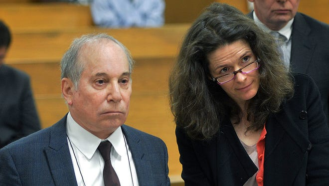 Paul Simon holds hands with his wife Edie Brickell at a hearing in Norwalk Superior Court on Monday in Norwalk, Conn.