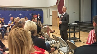 Co-interim superintendent Roger McMichael addresses a crowd of parents and community members during an informational meeting April 25 at Carmel Elementary School. Parents argued against the idea of closing the school as a response to expected declines in elementary enrollment.