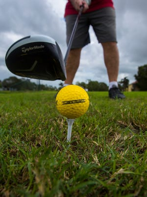 Cape Coral resident John Casazza practices at the Coral Oaks Golf Course driving range last October. Casazza first began visiting the golf course about six years ago.