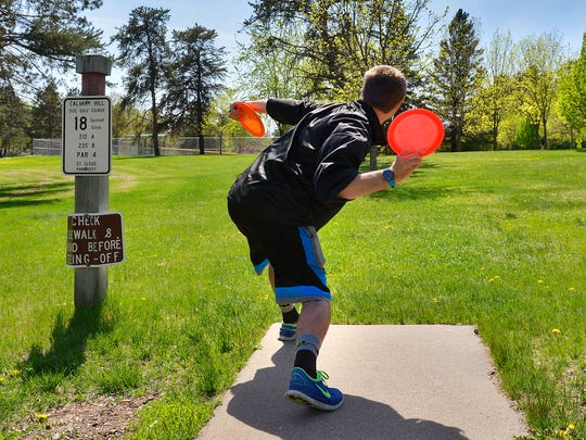 Zackary Judovsky throws his opening drive on the 18th hole of the Calvary Hill Park disc golf course Wednesday in St. Cloud.
