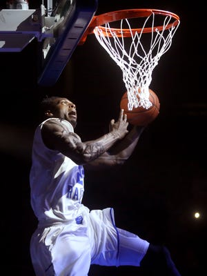 MTSU's Jacorey Williams comes from behind the goal as Williams compets in a dunk contest during MTSU's  Murphy Madness on Thursday Oct 29, 2015.
