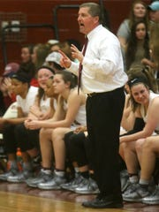Riverdale Coach Randy Coffman gives instruction to
