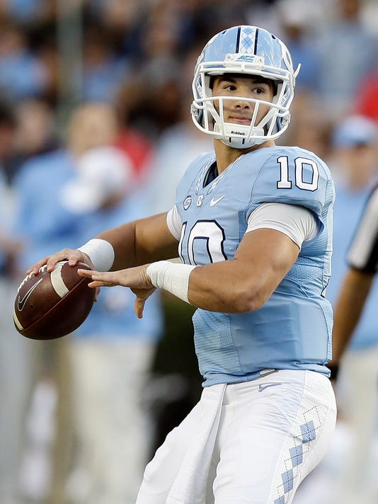 FILE - In this Nov. 19, 2016, file photo, North Carolina quarterback Mitch Trubisky (10) looks to pass against The Citadel during the first half of an NCAA college football game in Chapel Hill, N.C. The NFL Draft will be held April 27-29, 2017, in Philadelphia. (AP Photo/Gerry Broome, File)