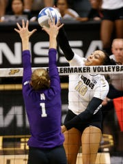 Azariah Stahl of Purdue tries to spike the ball past Taylor Tashima of Northwestern in the first set Wednesday, September 20, 2017, at Holloway Gymnasium on the campus of Purdue University. Purdue swept Northwestern 25-18, 25-20, 25-18.