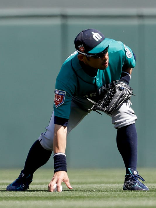 Seattle Mariners right fielder Ichiro Suzuki, of Japan, fields an RBI-single by Colorado Rockies' Trevor Story during the fifth inning of a spring baseball game in Scottsdale, Ariz., Tuesday, March 27, 2018. (AP Photo/Chris Carlson)