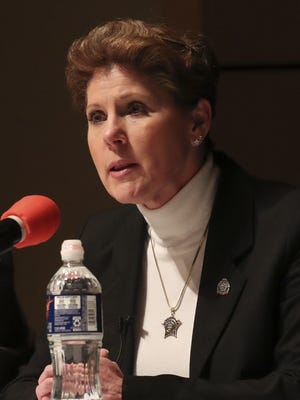 Kandy Fatheree answers a question in March during a debate of Democratic candidates for Summit County sheriff at the Akron-Summit County Public Library in Akron.