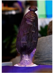 """Mina Wright, 14, used a two-liter bottle to prop her hair for her purple crayon costume she entered in the Oliver Jeffers Character Costume Contest. Mina's costume was inspired by Jeffers' book, """"The Day the Crayons Quit."""""""