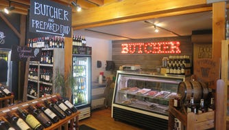 Inside, a gourmet take on the convenience store includes a section of fine wines, spirits and a full butcher shop.
