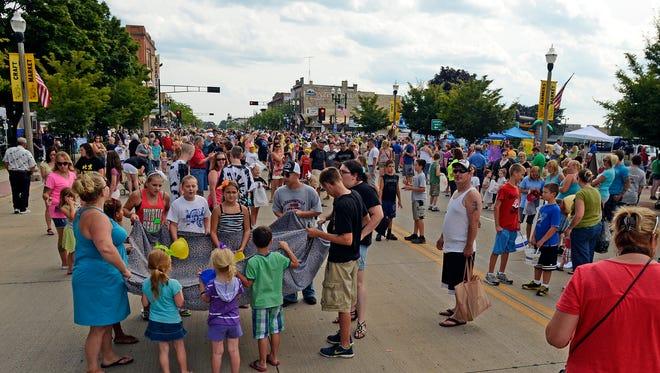 In this HTR Media file photo, hundreds pack Washington Street
