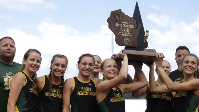 The Wittenberg-Birnamwood team celebrates after winning first place in  Division 2 on the second day of the WIAA state track and field meet in La Crosse.