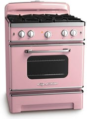 This photo provided by Big Chill shows an oven in the color of pink lemonade. With strong color trending in kitchens, Big Chill?s vibrant hues in fridges, ovens and range hoods hit the style mark.  As a pop of color in an otherwise low key kitchen, or as part of an overall exuberant space, appliances like these, particularly with some retro details, stand out from the standard stainless offerings. (AP Photo/Big Chill)