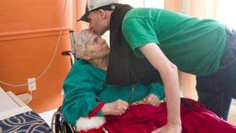 Florence Muchnick gets a goodbye kiss from her grandson Ryan after a visit on Christmas Eve. Muchnick, who has Alzheimer's disease, lives in a nursing facility in Fort Myers, Fla.