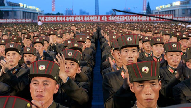 In this July 6, 2017, file photo, soldiers gather in Kim Il Sung Square in Pyongyang, North Korea, to celebrate the test launch of North Korea's first intercontinental ballistic missile two days earlier.