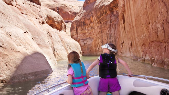 Kids taking in the beauty of the Colorado River at Glen Canyon National Recreation Area.