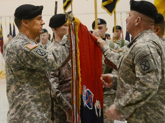 """ANI 3rd Brigade 10th Mountain Division Maj. Gen. Stephen J. Townsend (left), the 10th Mountain Division commander, and Command Sgt. Maj. Rodney """"Ray"""" Lewis (right), 10th Mountain Division command sergeant major, unfurl the flag activating the 3rd Brigade 1"""