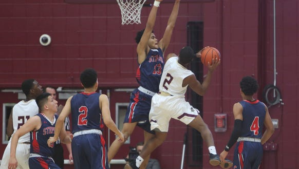 Iona Prep's Jacob Hargraves attempts a shot over Stepinac's Xavier Wilson during a game at Iona College's Hynes Center Feb. 3, 2018.