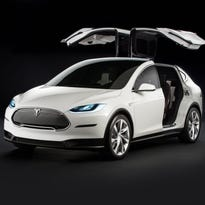 Tesla's Model X will be priced $5 more than the Model S dedan, Elon Musk says in a tweet.
