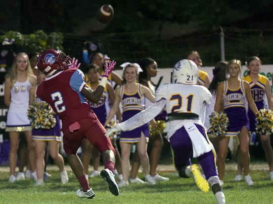 Minden's Tavarius Edwards catches the ball for a touchdown past Jalen Coleman of Benton in a battle of the District 1-4A leaders.