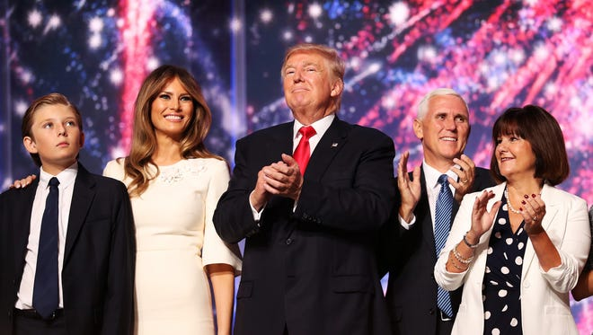 Barron Trump, Melania Trump, Republican presidential candidate Donald Trump, Republican vice presidential candidate Mike Pence and Karen Pence acknowledge the crowd at the end of the the Republican National Convention on July 21, 2016 at the Quicken Loans Arena in Cleveland, Ohio.
