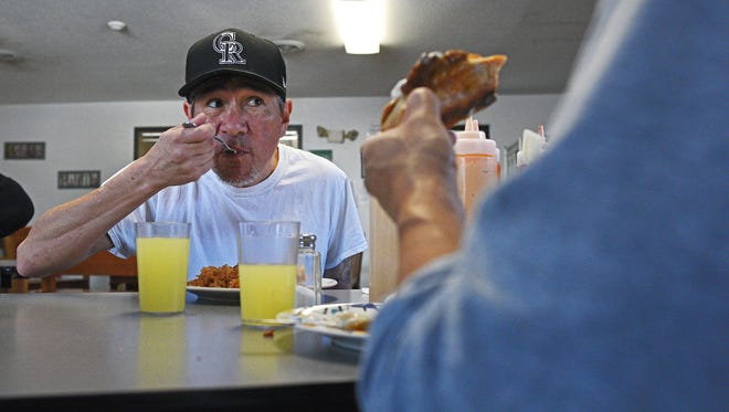 Joe Romero, a client at the Glory House, has lunch Thursday, Feb. 2, 2017, at the Glory House in Sioux Falls.