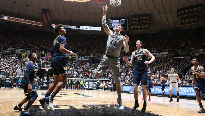 Jan 25, 2018; West Lafayette, IN, USA; Purdue Boilermakers center Isaac Haas (44) takes a shot against Michigan Wolverines center Jon Teske (15) during the first half at Mackey Arena. Mandatory Credit: Brian Spurlock-USA TODAY Sports