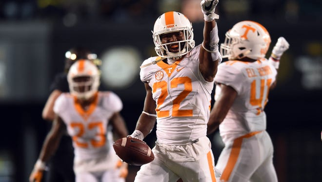 Tennessee defensive back Micah Abernathy (22) points to the crowd in celebration during the first half at Vanderbilt Stadium on Nov. 26, 2016.