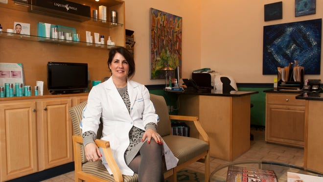 Dr. Karen Harkaway, MD, poses for a portrait in the poses for a portrait in the waiting area at The Harkaway Center for Skin Refinement in Delran on Monday, January 5, 2015.