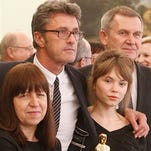 "Director of Oscar-winning Polish movie ""Ida,"" Piotr Pawlikowski, center, actress Agata Trzebuchowska, right,  and producer Ewa Puszczynska, left, with the award for the best foreign language movie pose for photographers before meeting Poland's President Bronislaw Komorowski at the Belvedere Palace in Warsaw, Poland on Monday."