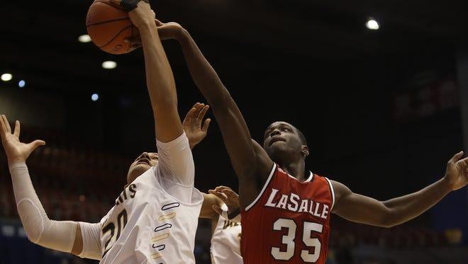 La Salle's Donte Buycks  battles Springfield's  Leonard Taylor for a rebound.