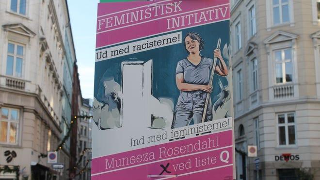 Feministisk Initiativ candidate Muneeza Rosendahl's campaign poster hangs in Sankt Hans Torv in Copenhagen.