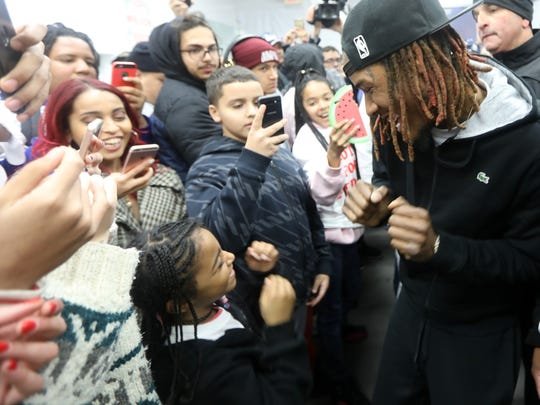 Fetty Wap dances with a young fan at Pedro Rodriguez's campaign headquarters Sunday