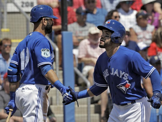 A healthy Devon Travis, right, and the return Jose Bautista, left, still gives the Blue Jays a lethal lineup, even with the departures of Edwin Encarnacion and Michael Saunders.