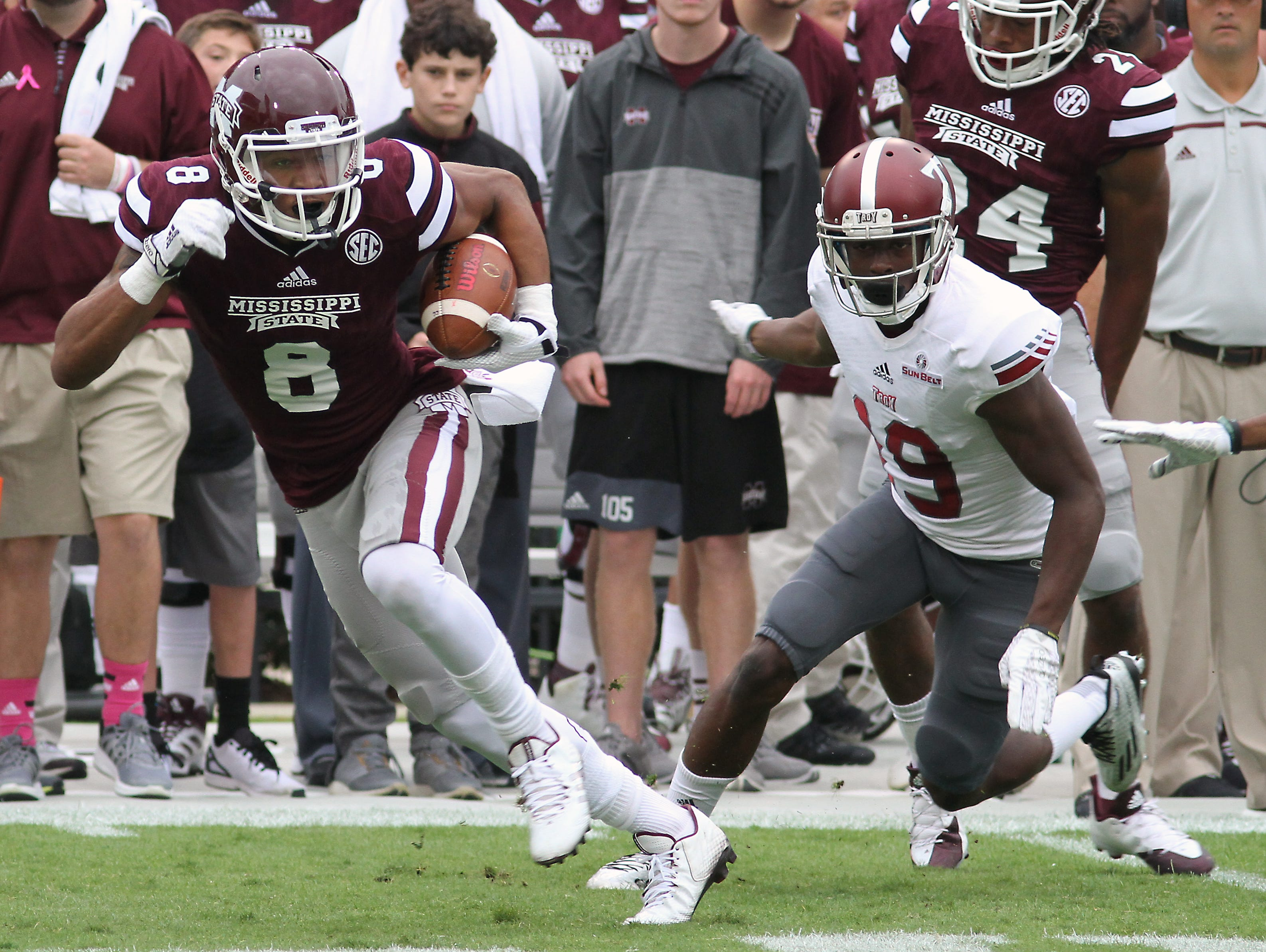 Mississippi State wide receiver Fred Ross (8) runs from Troy cornerback Jalen Harris (19) and for the end zone during the first half of an NCAA college football game in Starkville, Miss., Saturday, Oct. 10, 2015. (AP Photo/Jim Lytle)