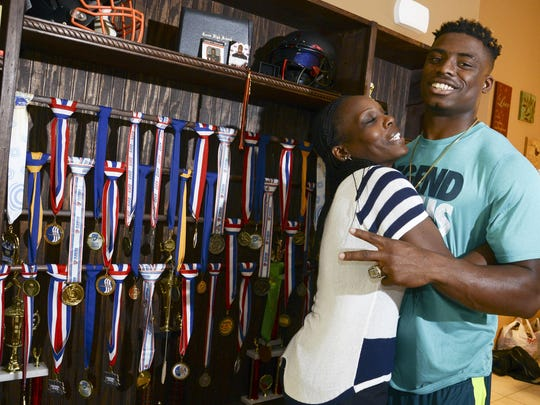 Chauncey Gardner-Johnson stands with his mother Delatron Johnson in their Cocoa home in the FLORIDA TODAY File photo.