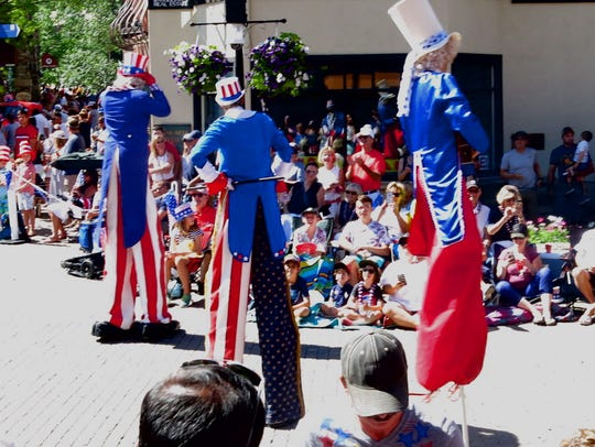 "Uncle Sams of many stripes parade on stilts at ""Vail"