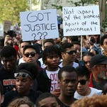 Students from Baltimore colleges and high schools march Wednesday.