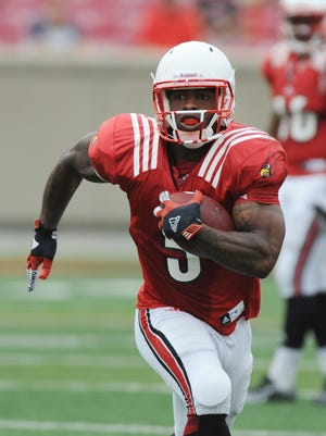 Louisville running back Michael Dyer gains yardage during a scrimmage game on Saturday at Papa John's Cardinal Stadium. (By David Lee Hartlage, Special to the C-J) Aug. 16, 2014.