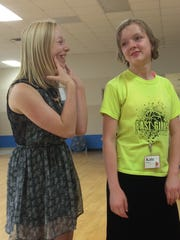 Mentor Natalie Ollhoff, 16, (left) works with Kate