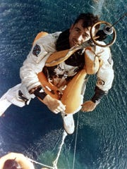 Astronaut John Young is hoisted aboard a helicopter after his Gemini 10 flight in 1966.